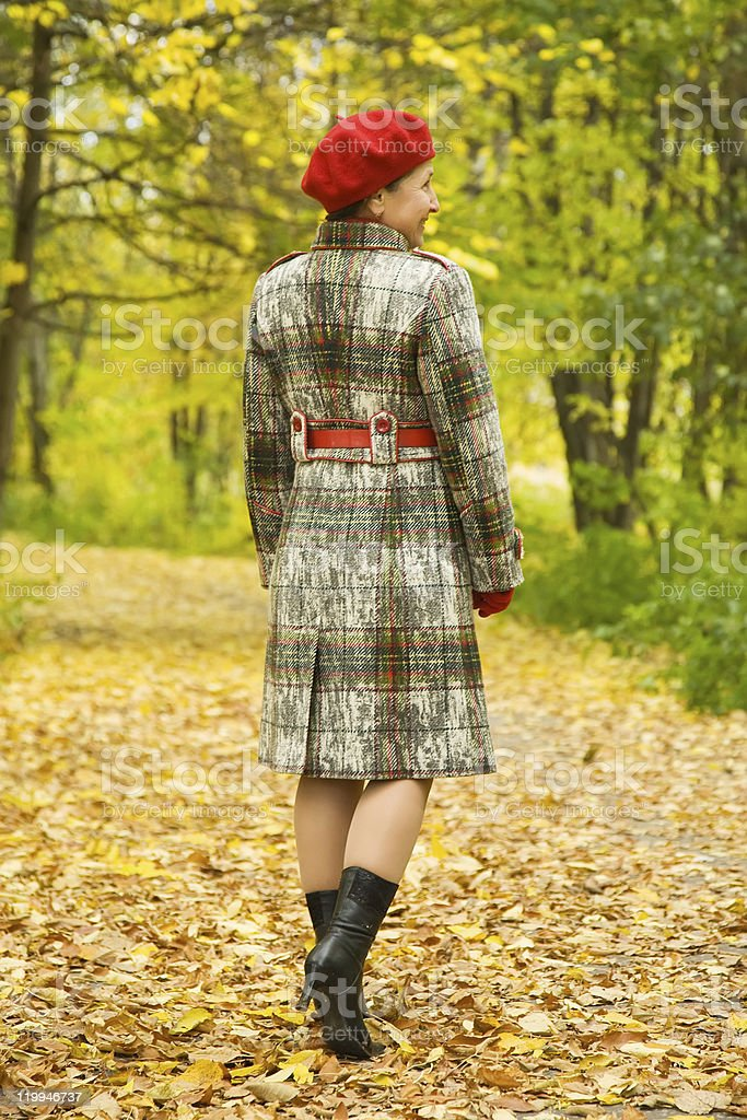 elderly woman walking  in autumn royalty-free stock photo