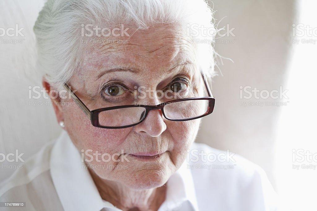 Elderly woman wearing eyeglasses stock photo