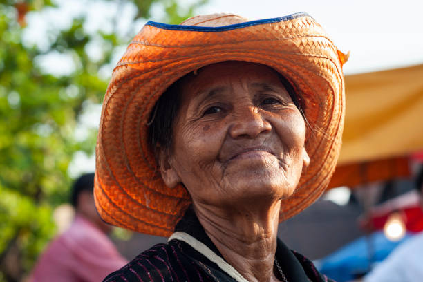 elderly woman wearing farmer hat Nakhon Ratchasima, Thailand - February 05, 2012 : Unidentified elderly woman wearing farmer hat in the market Huai Thalaeng district, Nakhon Ratchasima, Thailand. old and poor asian woman stock pictures, royalty-free photos & images
