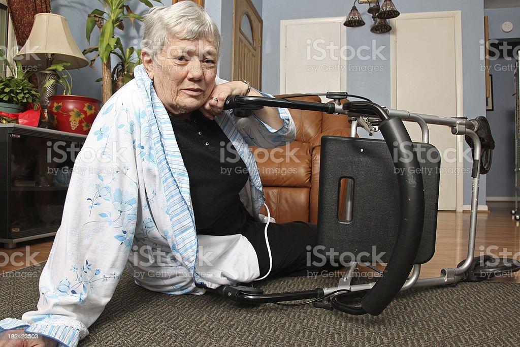 Elderly woman who has fallen with walker. royalty-free stock photo