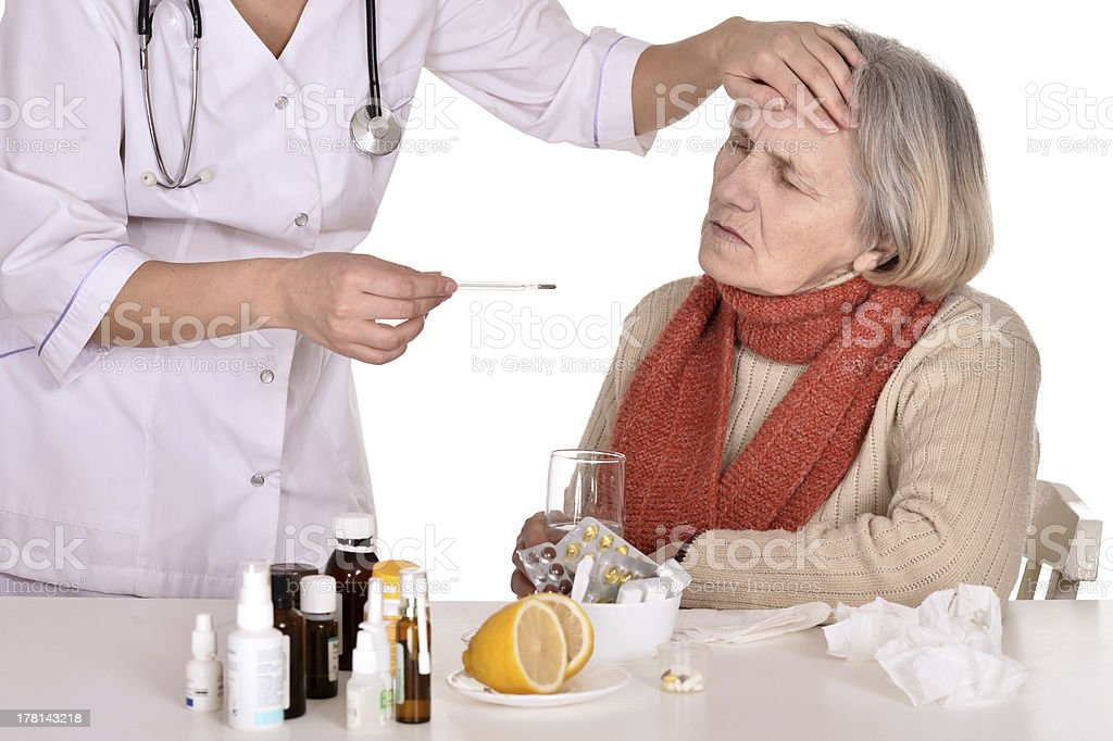 elderly woman with a nurse royalty-free stock photo