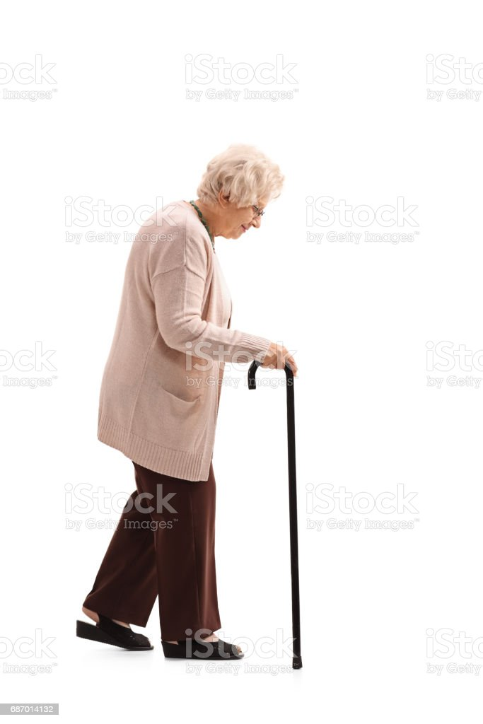 Elderly woman with a walking cane stock photo
