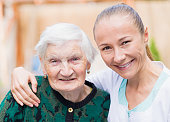 istock Elderly woman with caregiver 671764162