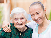 istock Elderly woman with caregiver 671764412