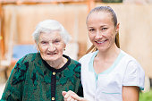 istock Elderly woman with caregiver 671764752