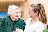 istock Elderly woman with caregiver 671767170