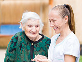 istock Elderly woman with caregiver 671767300
