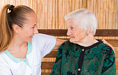 istock Elderly woman with caregiver 671951544