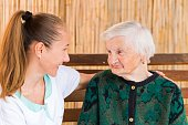 istock Elderly woman with caregiver 671951718