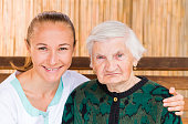 istock Elderly woman with caregiver 671951856