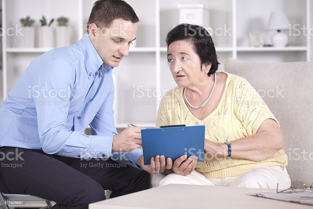 Elderly woman with consultant. royalty-free stock photo