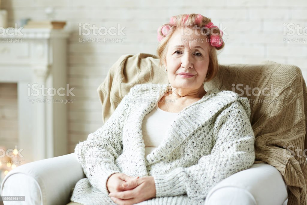 Elderly woman with hair rollers - Photo