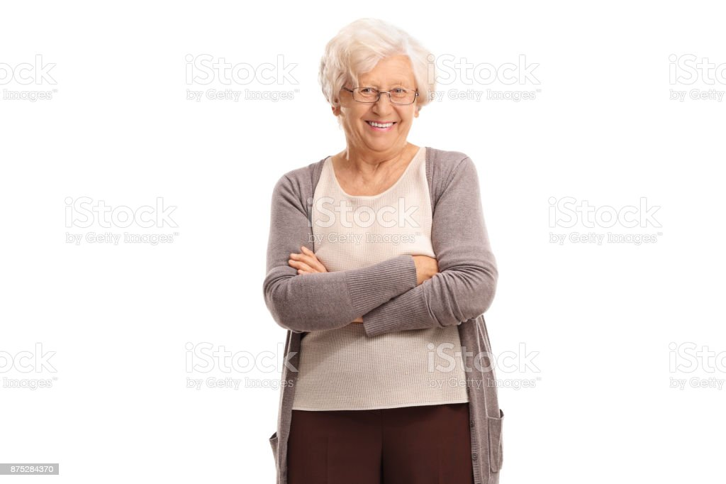 Elderly woman with her arms crossed stock photo