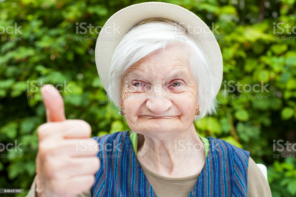 Elderly woman with mental disorder stock photo