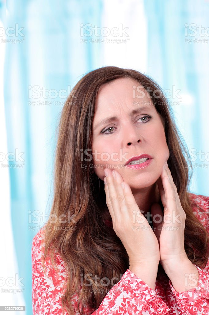 Elderly woman with tooth ache stock photo