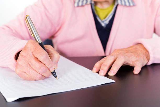 Elderly woman writing – Foto