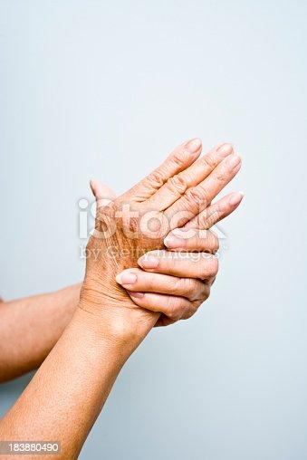 istock Elderly woman's with arthritis in her hands 183880490