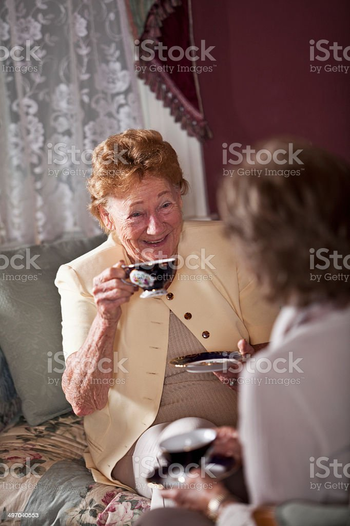 Elderly women drinking tea stock photo
