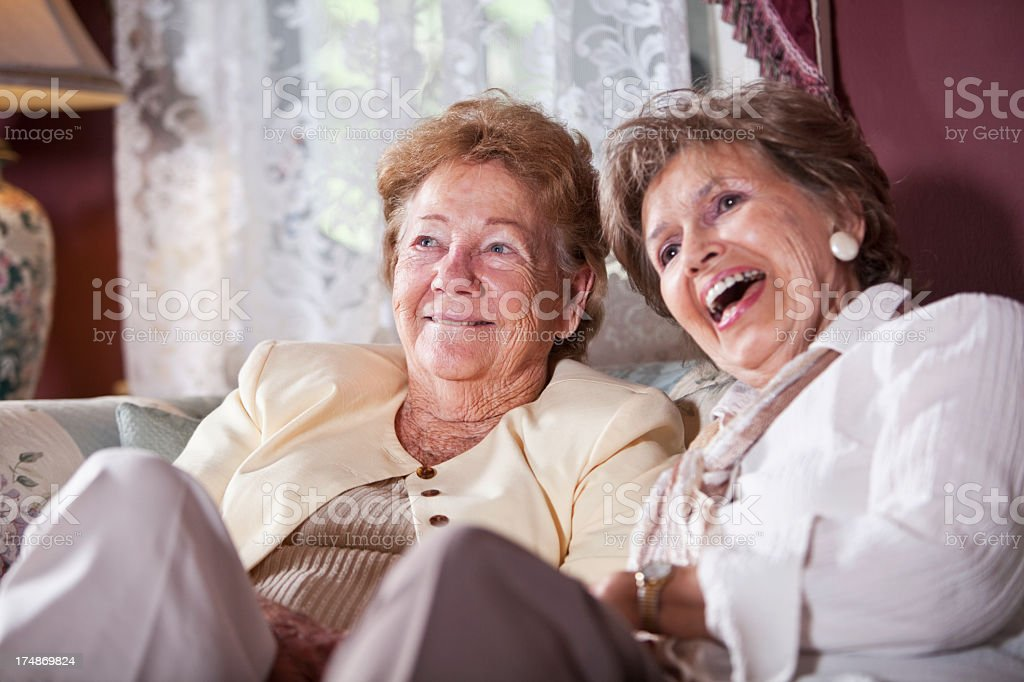 Elderly women on living room sofa stock photo