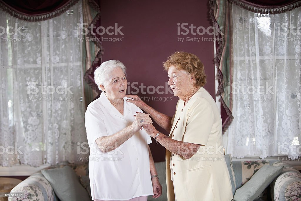 Elderly women standing in living room stock photo