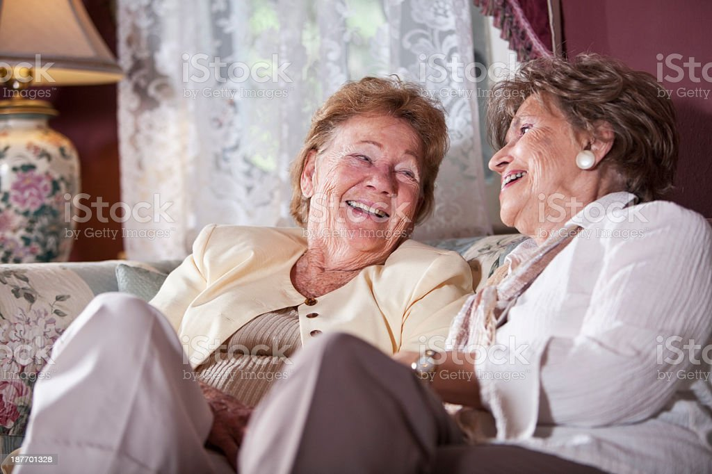 Elderly women talking and laughing stock photo