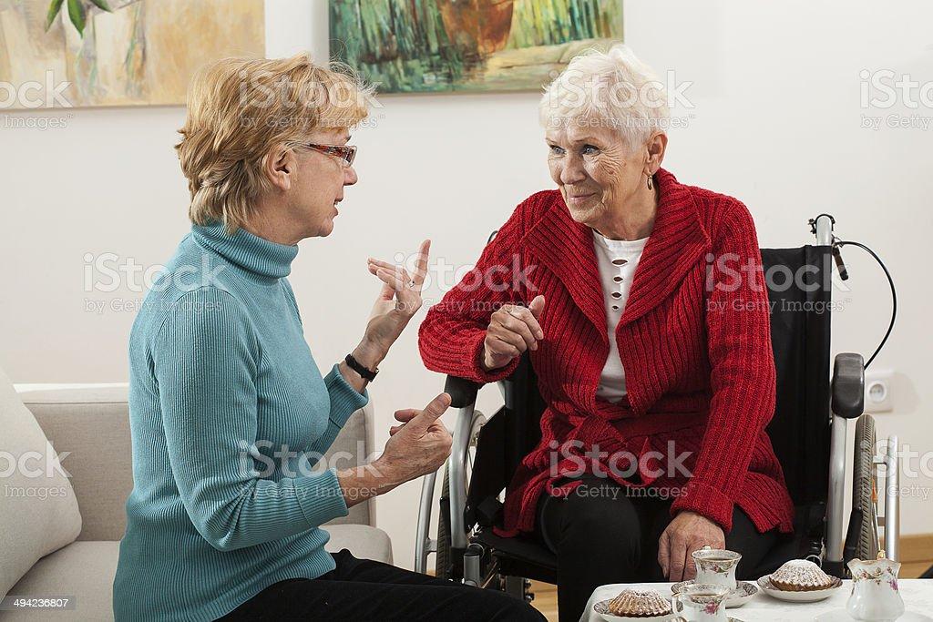 Elderly women talking stock photo