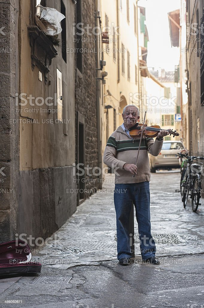 eldery italian man is playing a violin royalty-free stock photo