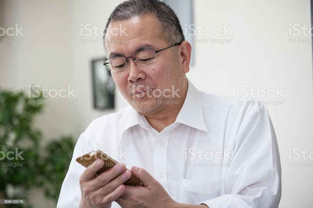 Eldery Japanese business man with glasses stock photo