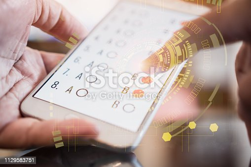 istock E-learning exam or online learning for student in smartphone by finger clicking multichoice  with sci fi futuristic user interface virtual graphic touch, educational technology by internet 1129583751
