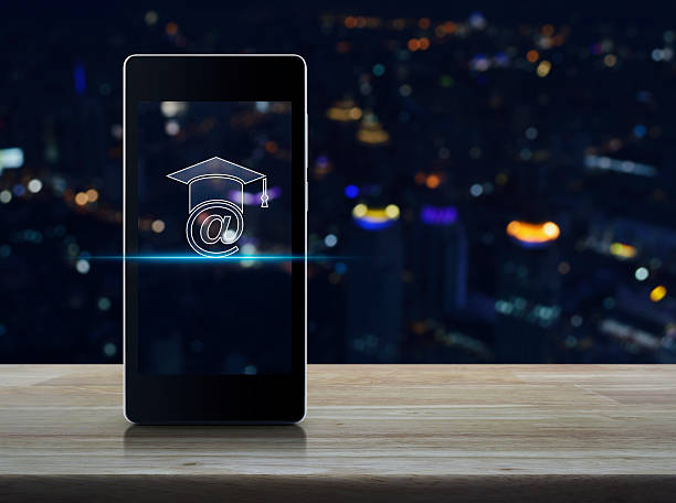 E-learning icon on modern smart phone screen on table stock photo