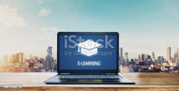 istock E-learning on computer laptop and city sunrise background. Online education, e-learning and e-book concept 1037245710