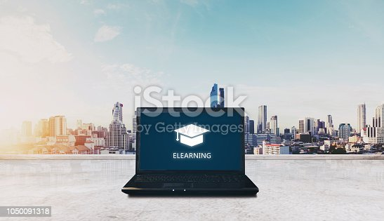 istock E-learning on computer laptop and city sunrise background. Online education, e-learning concept 1050091318