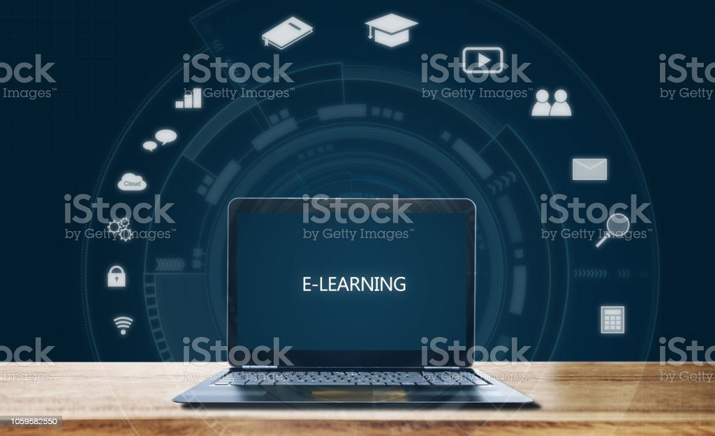 E-learning on computer laptop, on wooden table. Online education, e-learning, and education media concept stock photo