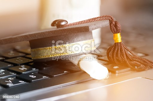 istock E-learning online graduate education concept : Graduation cap, certificate degree on laptop computer that can learn distant by internet, it selection of appropriate multimedia enhance learning. 959387240