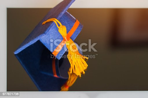 959387240 istock photo E-learning online graduate education concept : Graduation cap, certificate degree on tablet computer background. Elearning can learn distant by internet enhance study, back to school, Top view 977621738