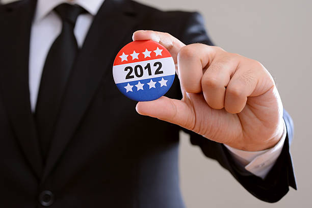 """Election 2012 """"Man in suit, showing a vote bagget. Election concept. Please see some similar pictures from my portfolio:"""" 2012 stock pictures, royalty-free photos & images"""