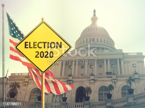 1157022917 istock photo Election 2020 sign with american flag on background 1137798311