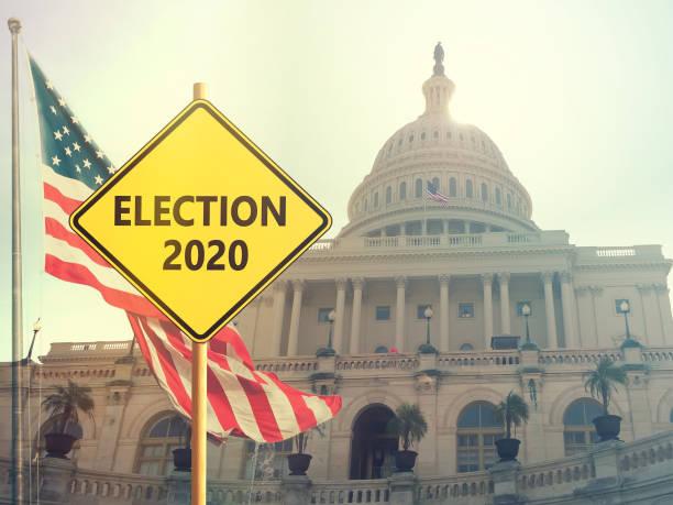 seçim 2020 arka planda amerikan bayrağı ile işaret - başkanlık seçimleri stok fotoğraflar ve resimler