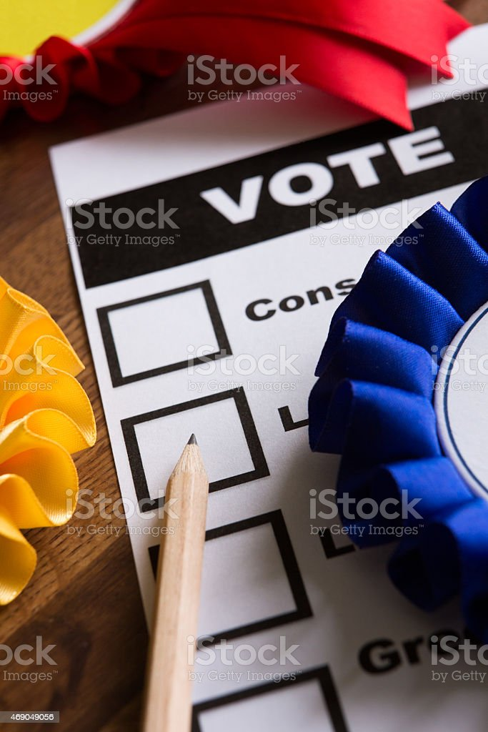 Election Ballot Paper With Rosettes Of Political Parties stock photo