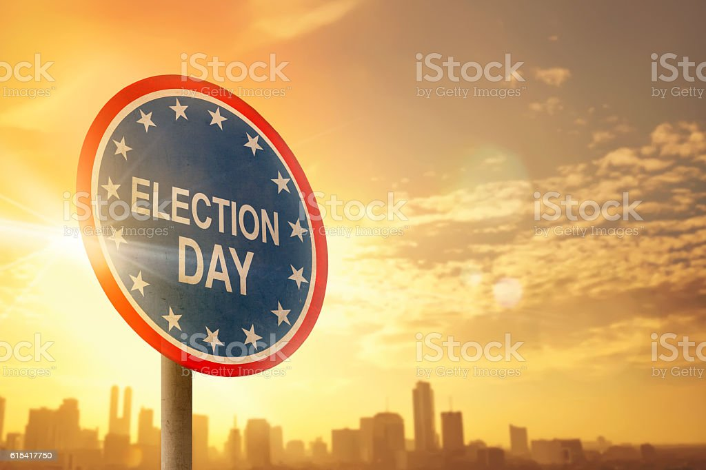 Election day sign with sunset stock photo