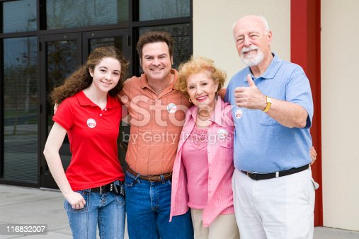 1001754954 istock photo Election - Family Outside Polls 116832007