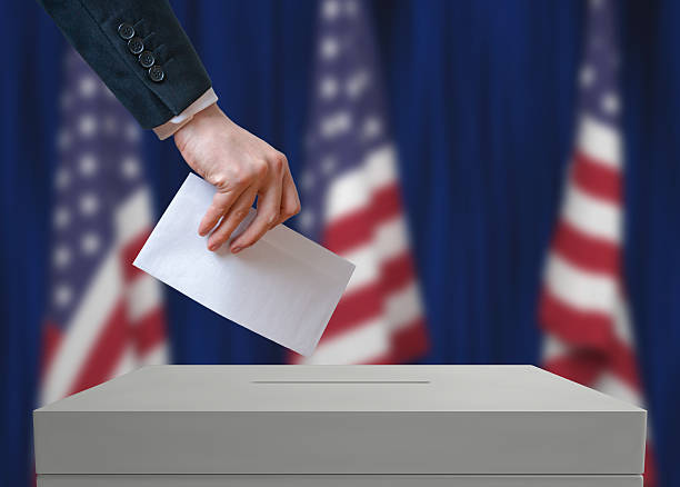 Election in United States of America. Voter holds envelope. stock photo