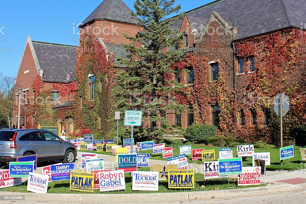 Election political lawn signs outside polling place at Village Hall stock photo