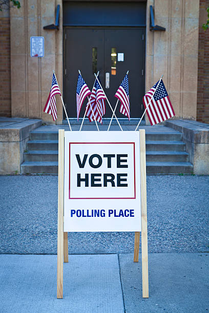usa election polling place station - vote sign stock photos and pictures