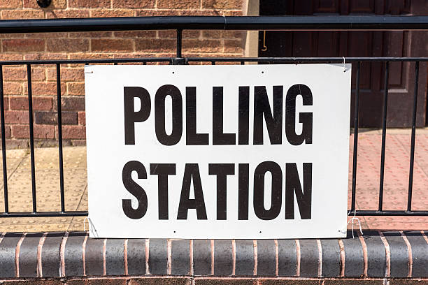 uk election 'polling station' sign - vote sign stock photos and pictures