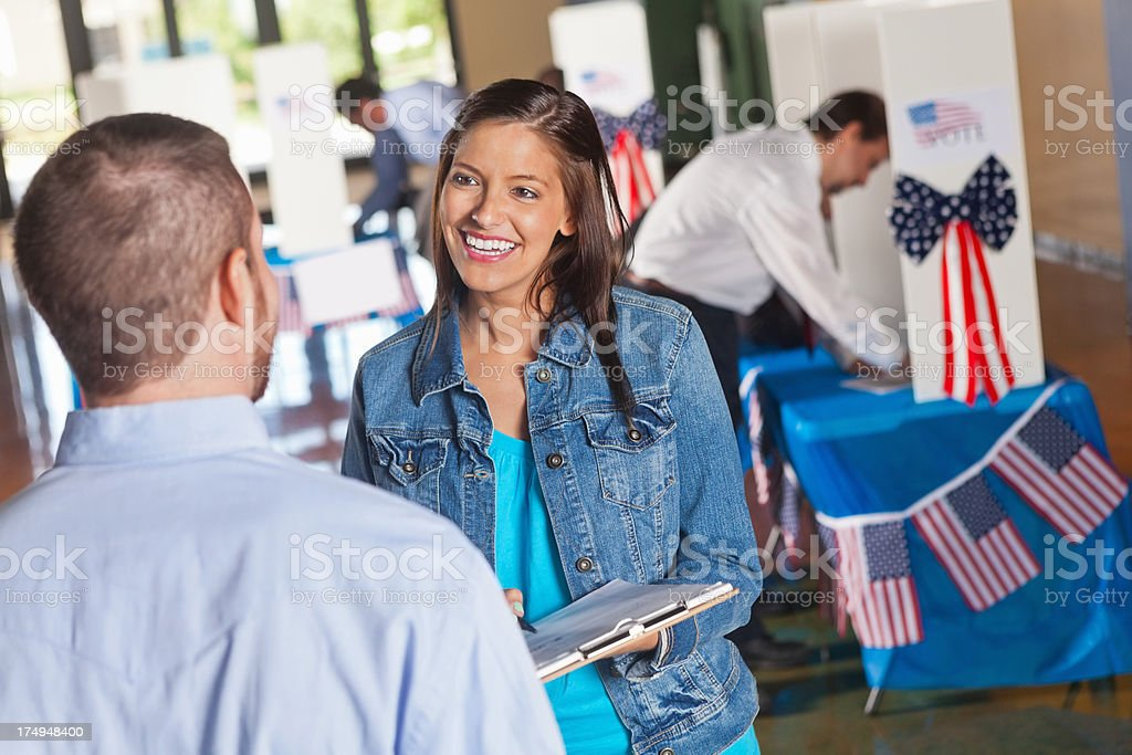 Election volunteer conversing with voters stock photo