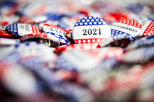 Closeup of election vote button with text that says 2021