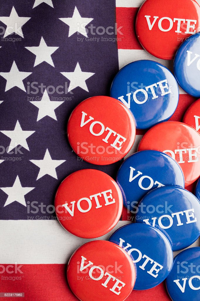 USA election vote button on a stars and stripes flag stock photo