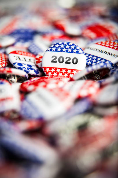 Election Vote Buttons 2020 Closeup of election vote button with text that says 2020 us president stock pictures, royalty-free photos & images