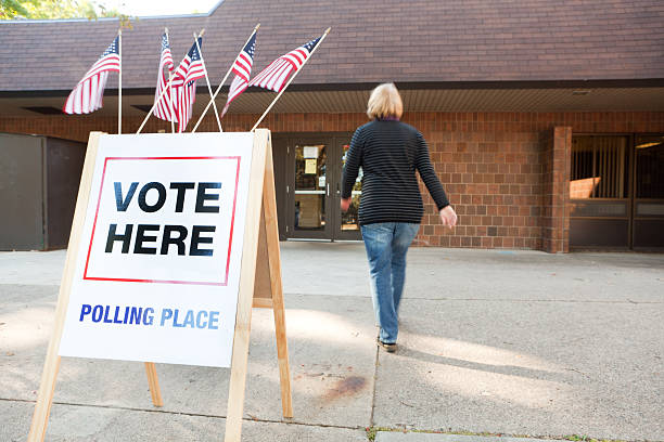 usa election voter going to polling place station hz - polling place stock pictures, royalty-free photos & images